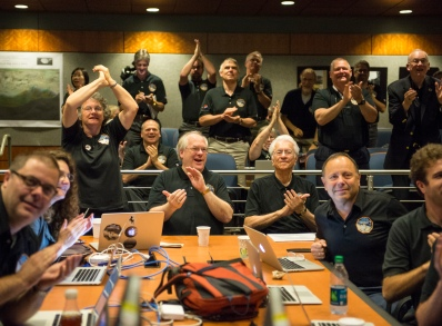 Members of the New Horizons science team react to seeing the spacecraft's last and sharpest image of Pluto Tuesday, July 14, 2015 (NASA/Bill Ingalls)